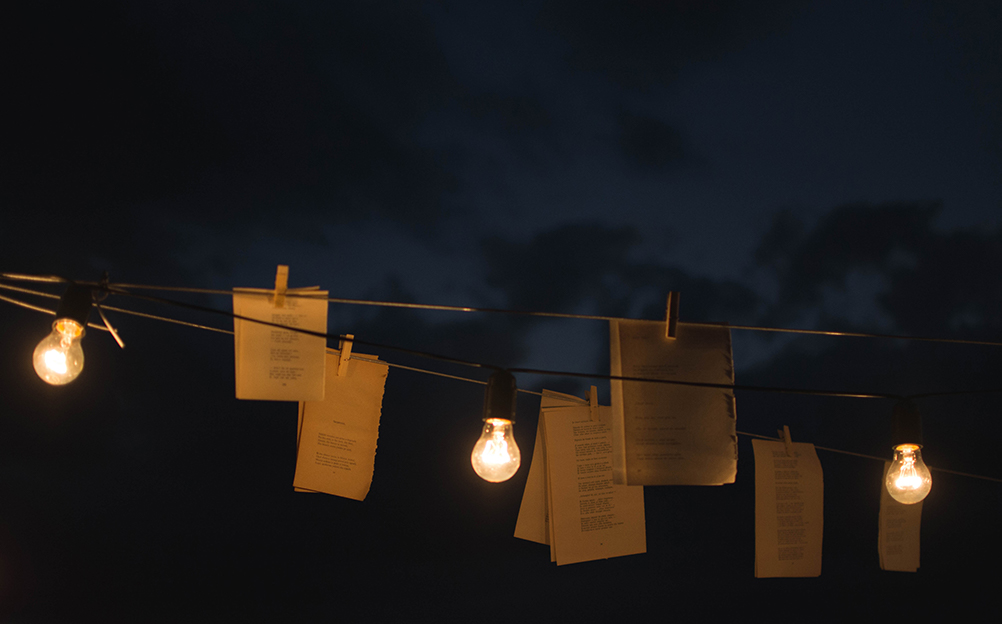 poems hanging on clothing line