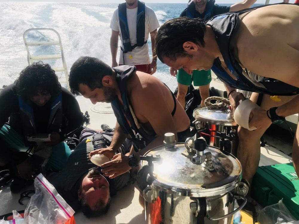 man on boat receiving oxygen