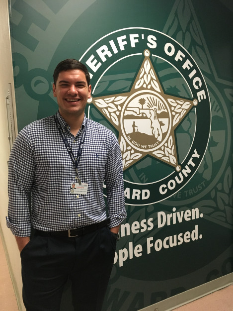 Student, Robert Coseano, at his internship with the Bureau of Human Resources at the Broward Sheriff's Office