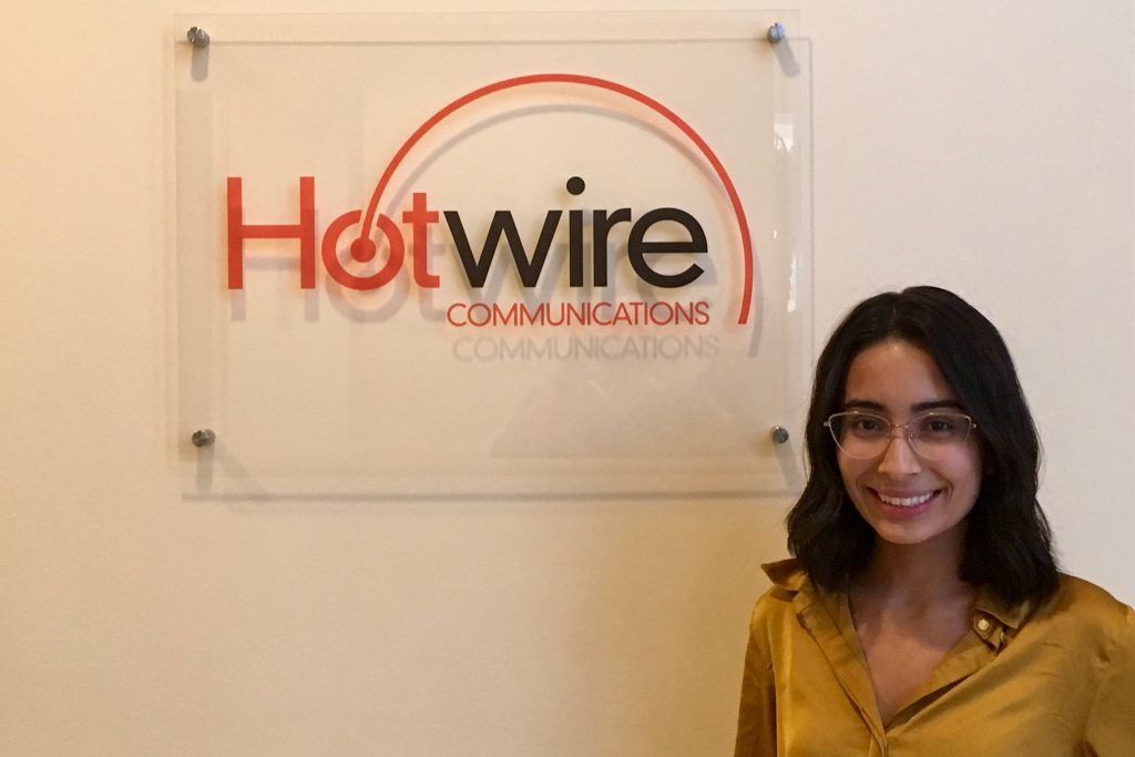 girl in front of hotwire communications logo