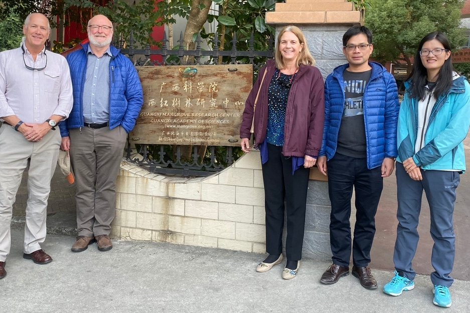 scientists in front of building