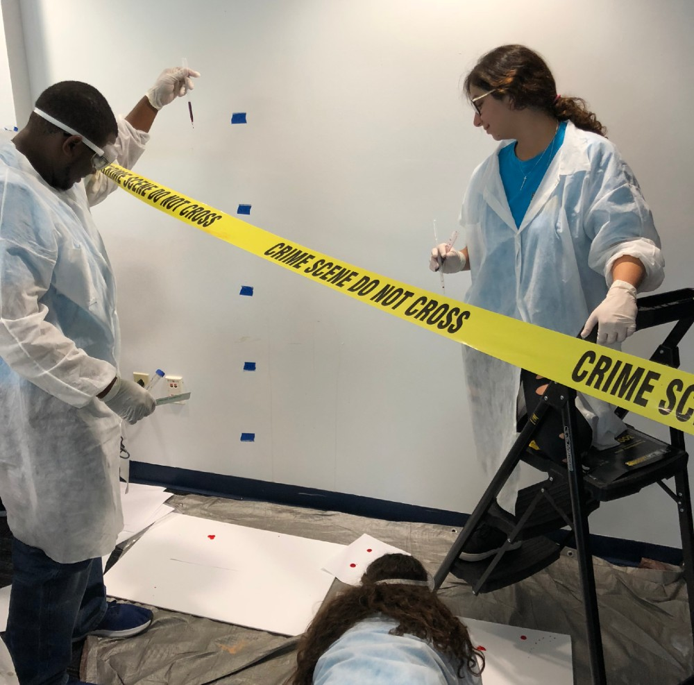 Students solving a crime in the CSI Camp