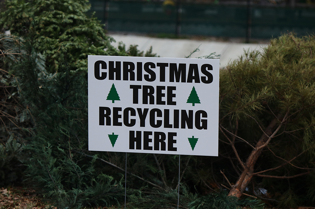 Christmas tree recycling here sign