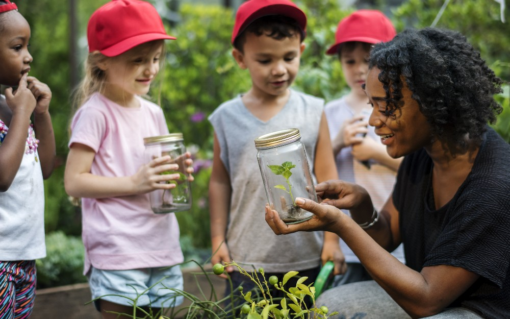 Environmental instructor teaching children