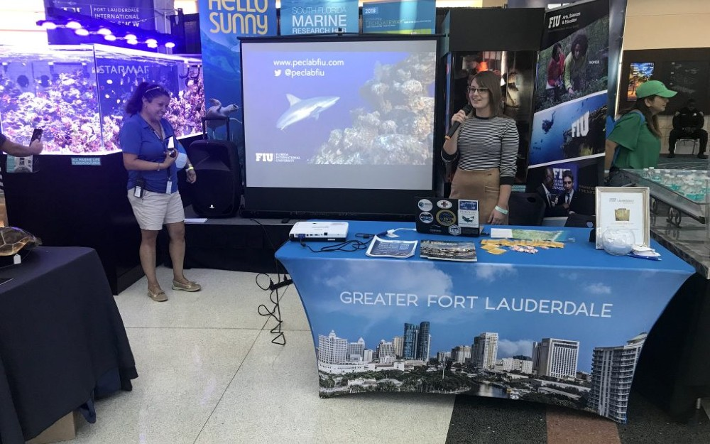 Student, Katie Flowers talking about sharks and rays at the boat show.