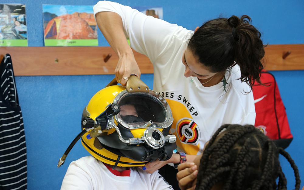 Students wearing diving helmet