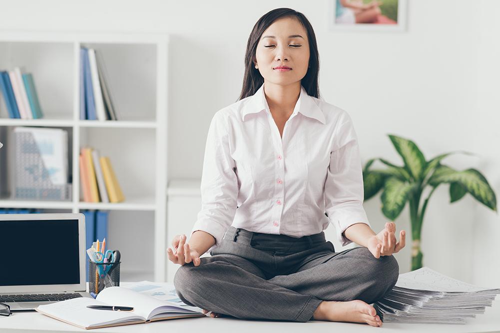 Female office worker meditating