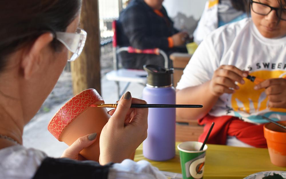 volunteer painting a pot