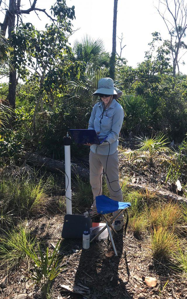 Dr. Ogurcak working in the field