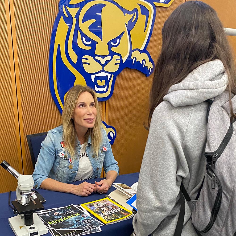 Mireya speaking to student