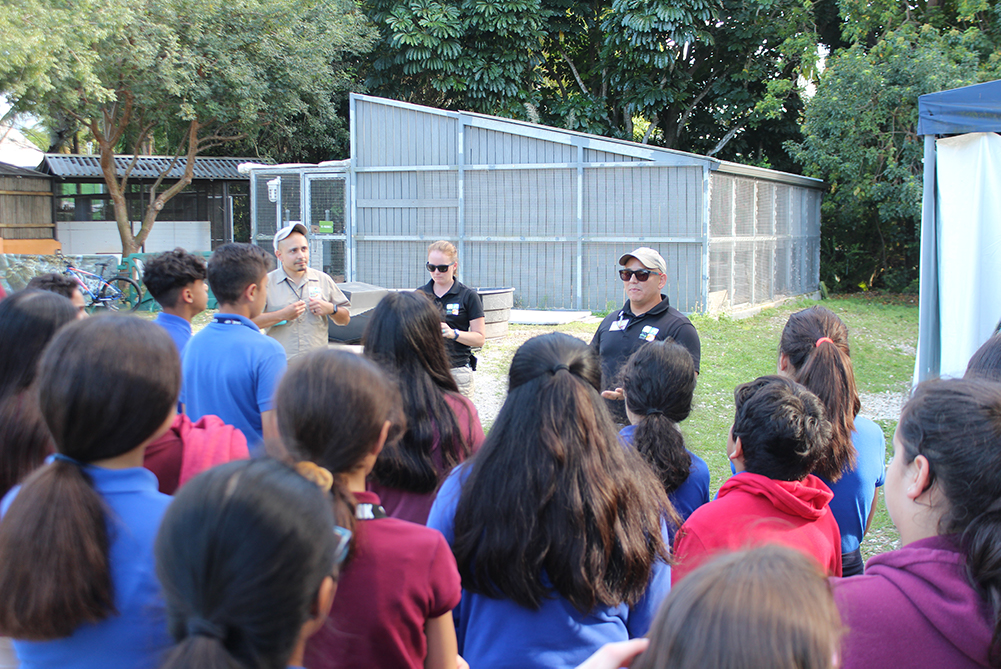 Students learning from key zoo staff