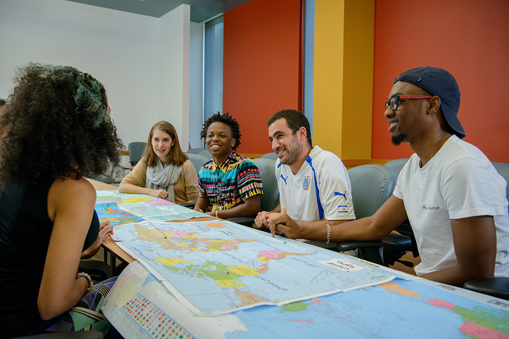 Students in class looking at a map