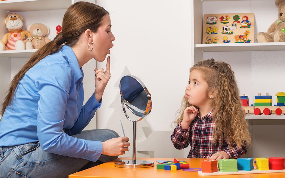 teacher teaching child