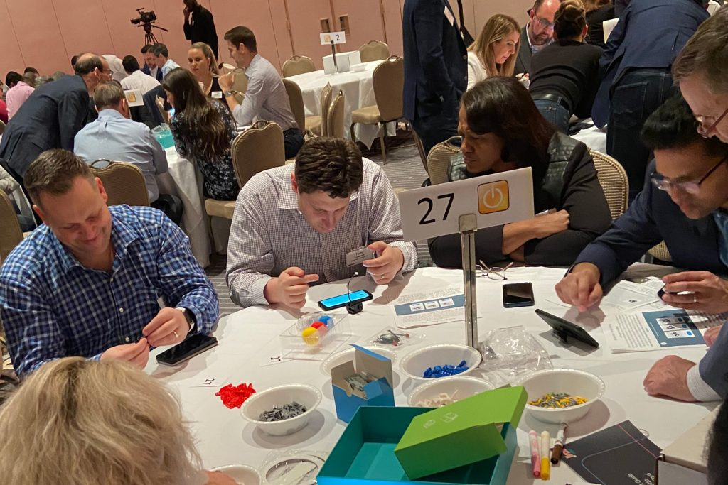people making robots at a conference