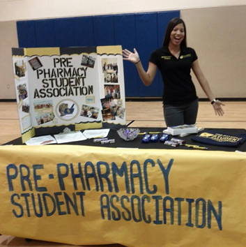 Stephanie Villasis with a Pre-Pharmacy Student Association booth