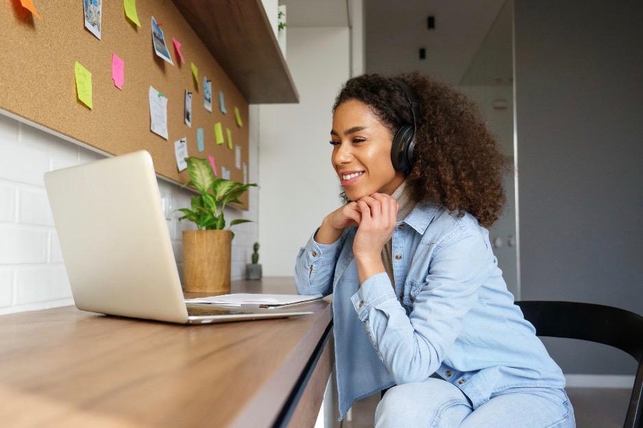 young woman watching a webinar