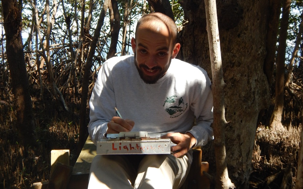Christian Fernandez collects data in the field