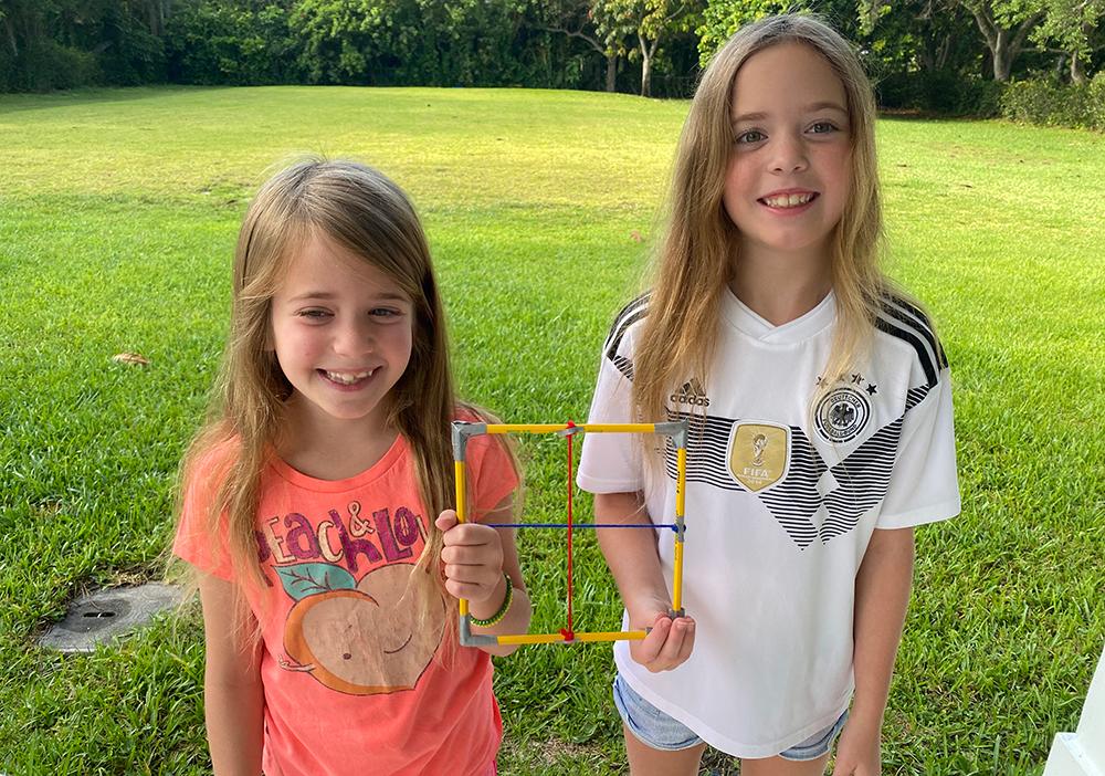 Kids holding quadrat they made