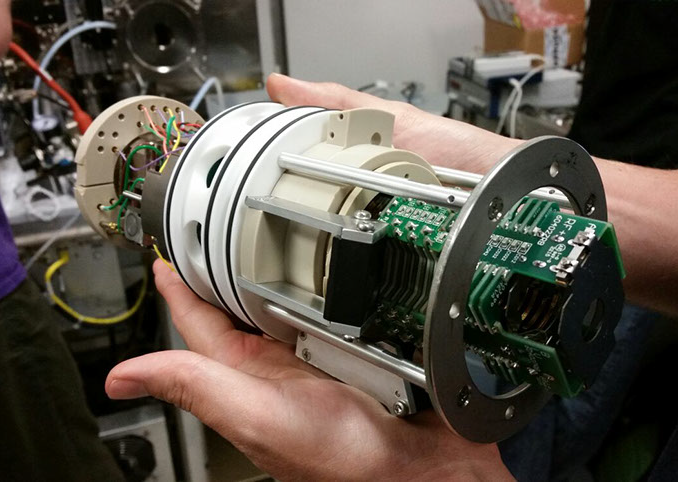 Custom built trapped ion mobility spectrometry cartridge coupled to Bruker source interface.