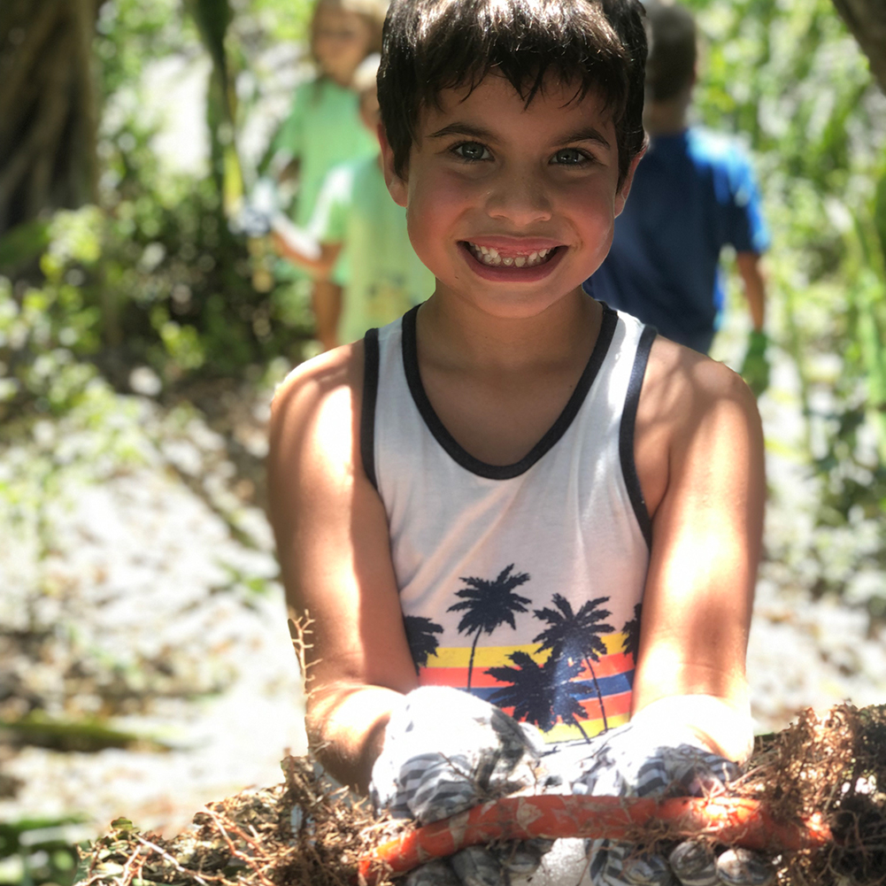 Boy holding plant roots