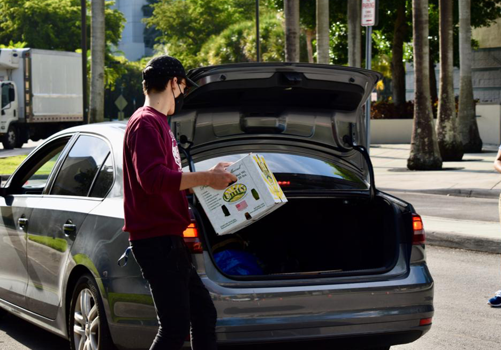Packing up car with produce