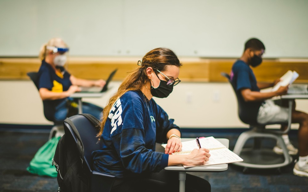 FIU students in a classroom.