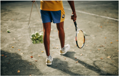 individual with tennis equipment