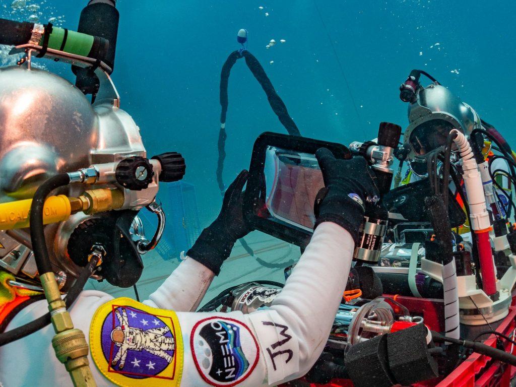 Aquanauts testing equipment during NEEMO 23