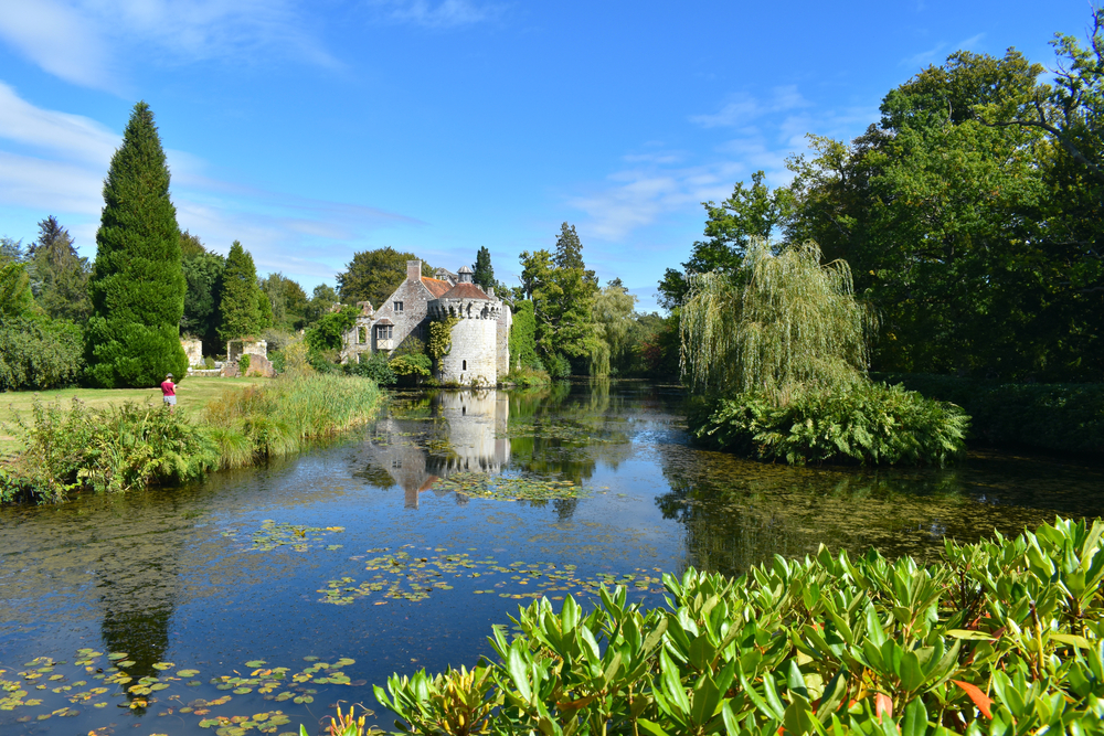 Romantic gardens with panoramic views of a moated fortress and a Victorian country mansion all in a wooded estate