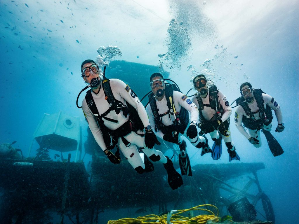 NEEMO 22 aquanauts swim outside the habitat