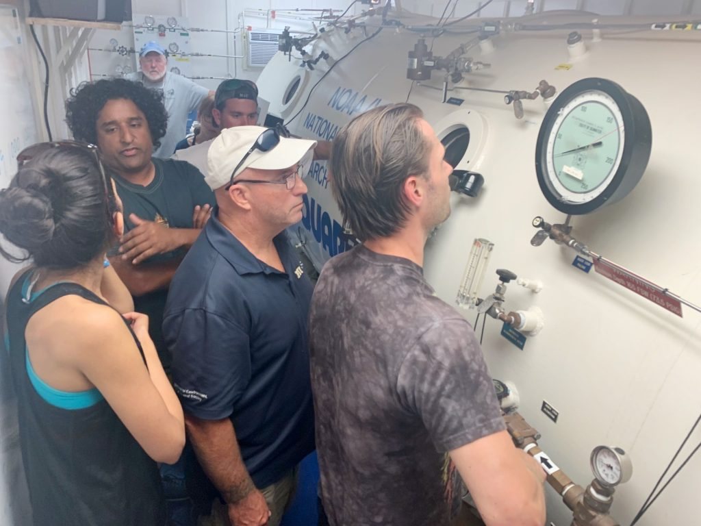 Student trains in recompression chamber operation